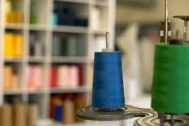 A sewing thread placed on a sewing machine's holder