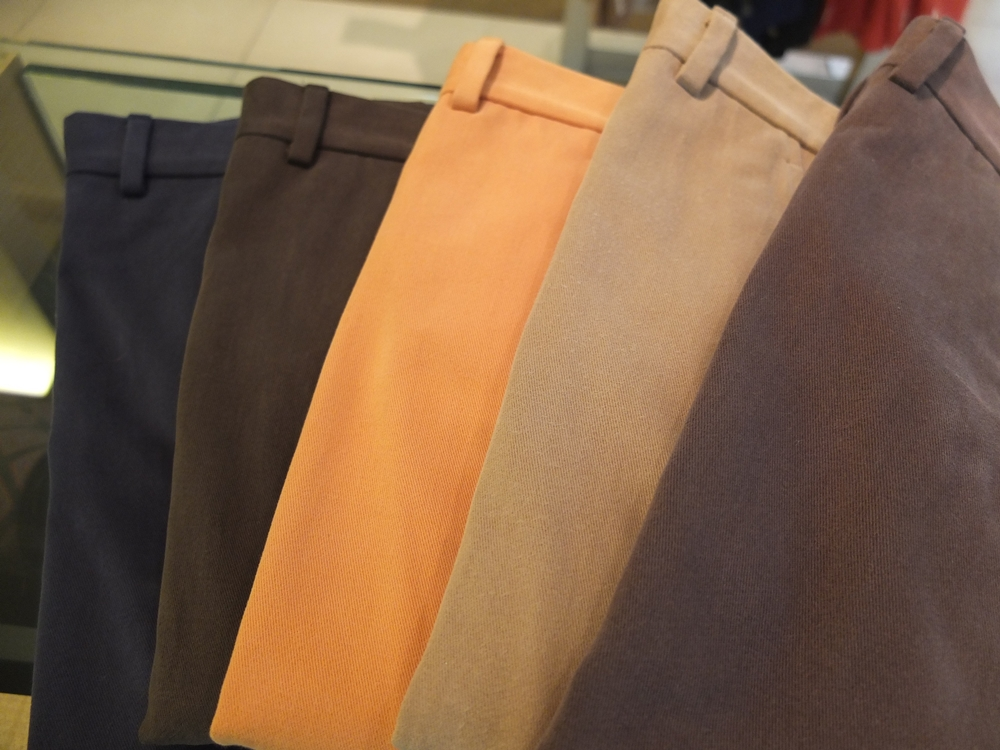 Five khaki pants with various colors.