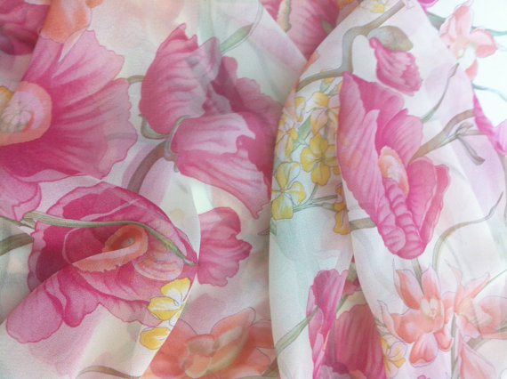 A pink floral print and chiffon made dress.