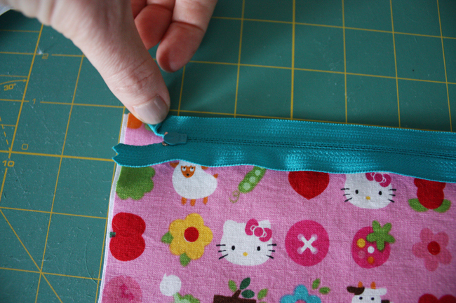 A zipper being attached to a DIY sewing made make up bag.