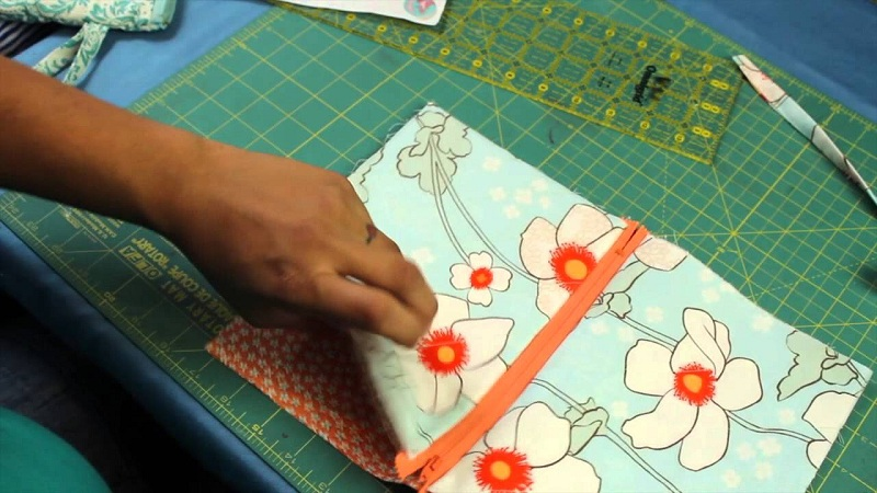 Fusing the sides of fabric, a step in sewing DIY make up bag.