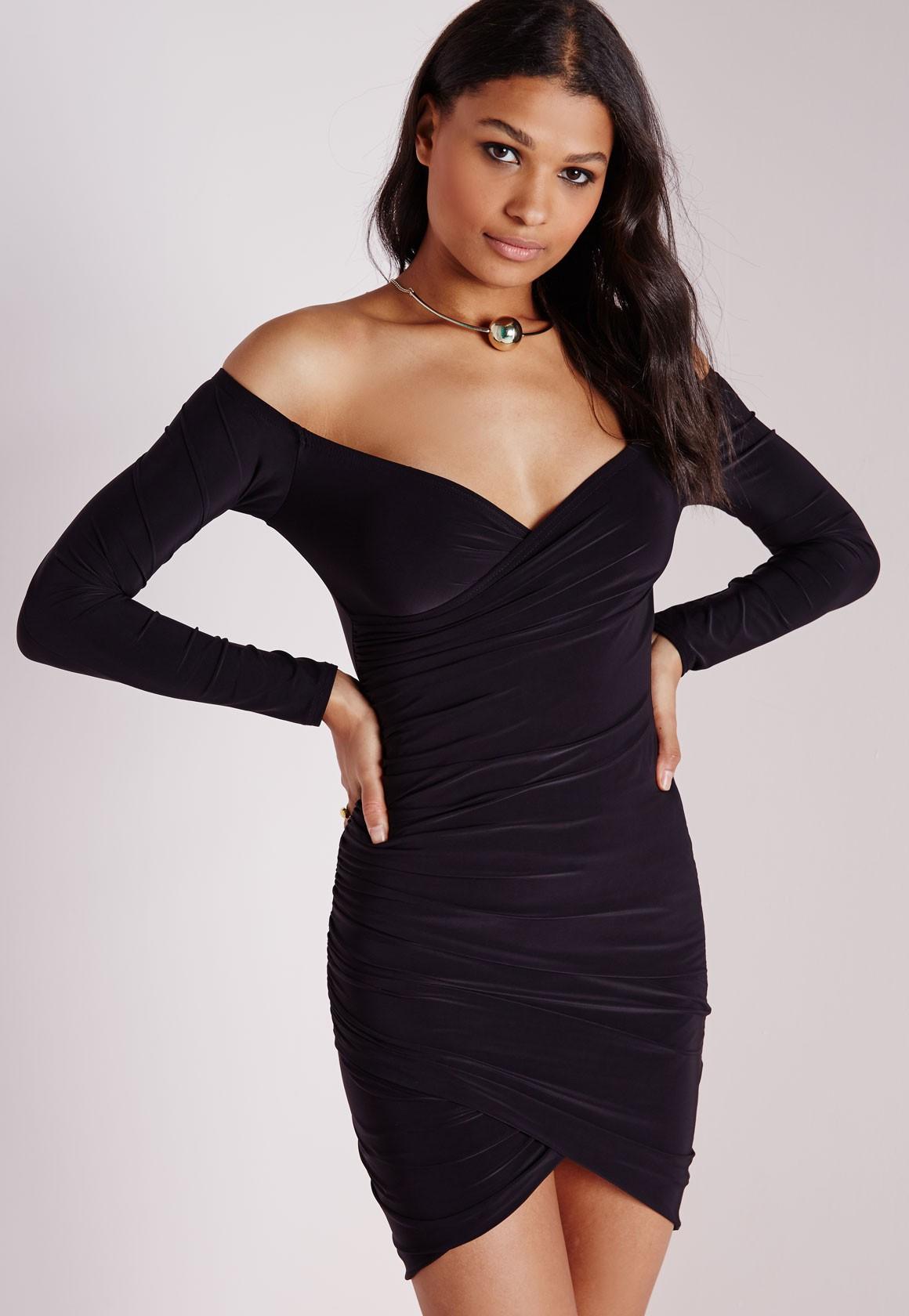 A woman wearing a Bardot dress.