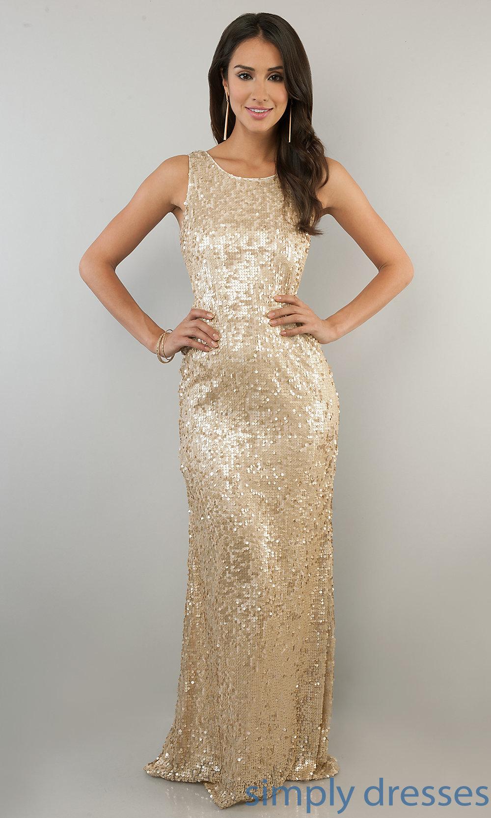 A woman wearing a Gold dress.