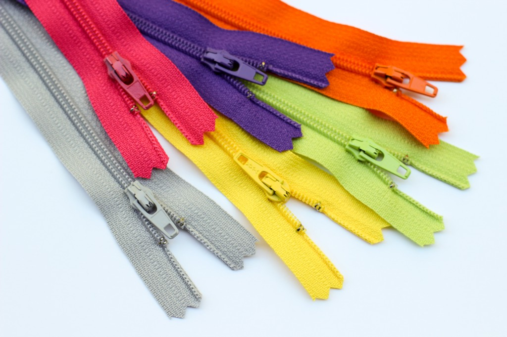 A set of colorful zippers.