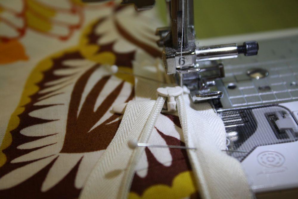 Sewing machine and a zipper.